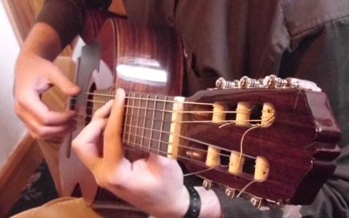 Martin playing his Classical guitar.